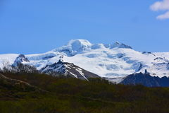 Snöberg i Island Arkivfoto