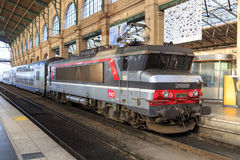 SNCF train in station. SNCF train with locomotive and doubledecker carriages at Paris Gare du Nord station Stock Photo