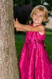 Sneak peek girl royalty free stock image
