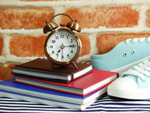 Sneaker and alarm clock with notebook and diary with space copy Royalty Free Stock Photos
