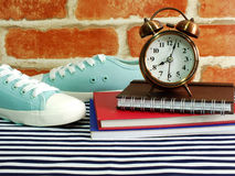 Sneaker and alarm clock with notebook and diary with space copy Royalty Free Stock Image