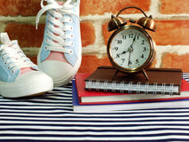 Sneaker and alarm clock with notebook and diary with space copy Stock Image