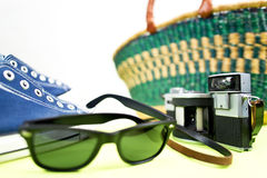 Sneaker analogue camera and handbasket Stock Photography