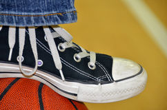 Sneaker on a basketball Royalty Free Stock Photos