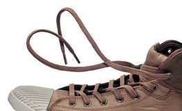 Sneaker boot. A sneaker boot with its shoelaces tied as a heart Stock Images
