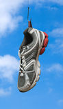 Sneaker on fishing hook Stock Images