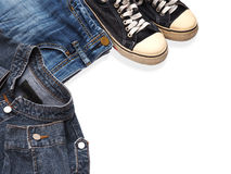 Sneaker shoe and fashionable jean denims Royalty Free Stock Photo