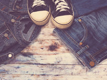 Sneaker shoe and fashionable jean denims Stock Images