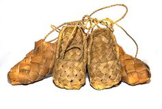 Sneaker woodsneaker wood woven birch sandals for everyday wear in the village on a wooden background Stock Photo
