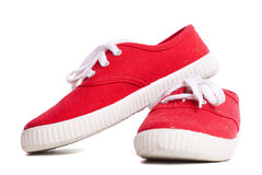 Sneakers. Red vivid new Sneakers isolated Royalty Free Stock Photography