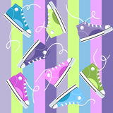 Sneakers. Colored funny sneakers on striped seamless background Royalty Free Stock Photos