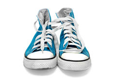 Sneakers. A pair of blue sneakers isolated on a white background Stock Photos