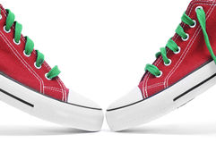 Sneakers. A pair of red sneakers with green shoelaces on a white background Stock Images