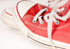 Sneakers. Casual red shoes on white background Stock Photography