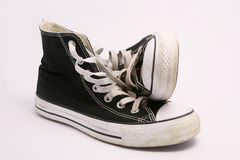 Sneakers. Pair of black sneakers isolated on white Royalty Free Stock Images