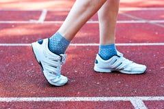 Sneakers. Foot girl who is preparing to run Stock Image