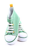 Sneakers. Pair of green sneakers for children isolated on white Royalty Free Stock Photography