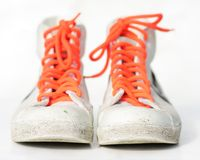 Sneakers. Old retro sneakers with orange laces, on white, shallow depth of field Stock Images