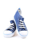 Sneakers. Pair of blue sneakers isolated on white Stock Photography