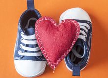 Cute little baby shoes. Sneakers for baby on the colorful background Stock Images