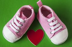 Cute little baby shoes. Sneakers for baby on the colorful background Royalty Free Stock Images