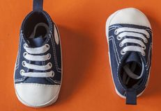 Cute little baby shoes. Sneakers for baby on the colorful background Stock Photos