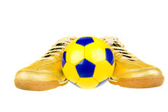 Sneakers and ball. Isolated on the white background Royalty Free Stock Images