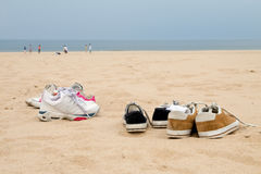 Sneakers on the Beach. Sneakers wait in the sand for their owners to finish playing on a Lake Michigan beach Stock Photo