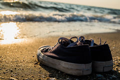 Sneakers on the beach stock photo