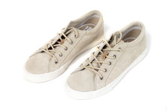 Sneakers. Beige sneakers on white background Royalty Free Stock Images