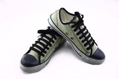 Sneakers bielu tło Zdjęcia Royalty Free