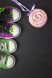 Sneakers on black board Royalty Free Stock Image