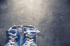 Sneakers blue color on background of a concrete wall Royalty Free Stock Photos