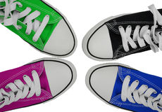 Sneakers blue, green, pink and black. Four colorful sneakers isolated on a white background royalty free stock images