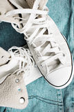 sneakers on blue jeans close-up Stock Photography