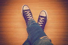 Sneakers and blue jeans, clothes teenagers Stock Images