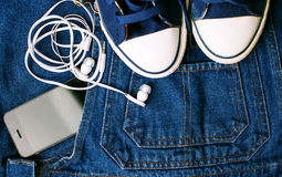 Sneakers, blue jeans and gadgets. Stock Images