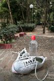 Sneakers and a bottle of water royalty free stock photos