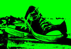 Sneakers. On the breakwater on the sea. Shallow depth of field; toned photo Stock Photos
