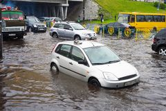 Traffic on flooded city road Royalty Free Stock Photo