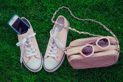 Sneakers, cellphone, purse and sunglasses Stock Photo