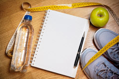Sneakers, centimeter, green apple, notebook,  bottle of water Stock Images