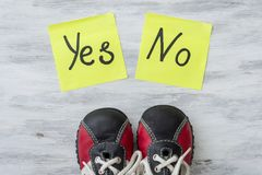 Sneakers. The choice between Yes and No. Royalty Free Stock Photo