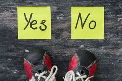 Sneakers. The choice between Yes and No. Stock Photography