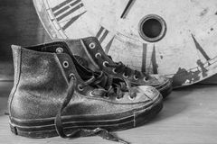 Sneakers and a clock with black and white. Stock Photography