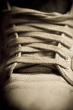 Sneakers close up. Sneakers shoes close up in retro style Stock Image