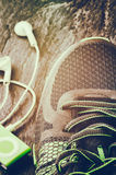 Sneakers closeup. Sneakers and music player closeup. Sport concept royalty free stock images