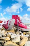 Sneakers on the coaast Royalty Free Stock Images