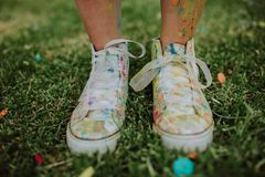 Sneakers colour. In grass with many diferent colours Stock Image
