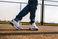 Sneakers dancer, Feet. Feet dancer, Sneakers run on asphalt Royalty Free Stock Photo